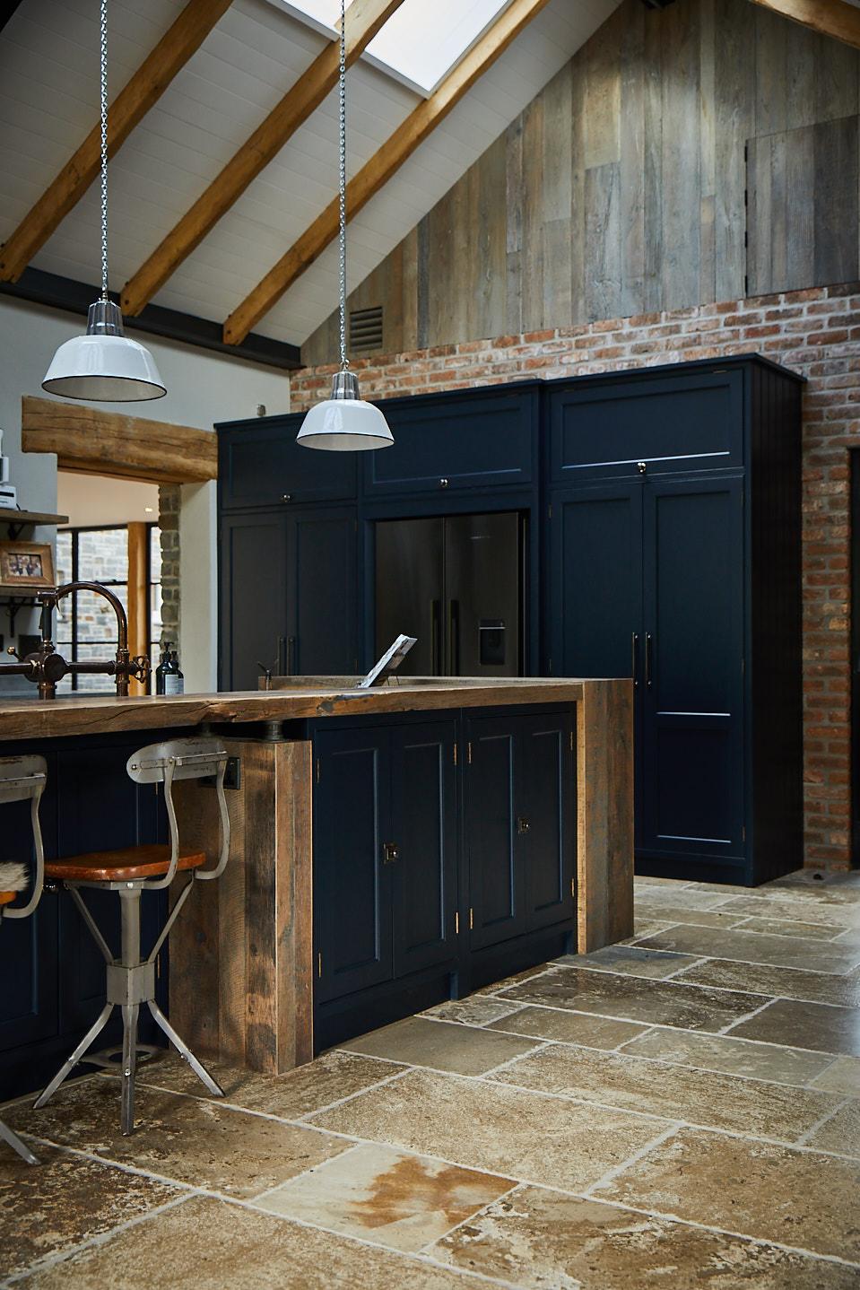 Gun metal Fisher & Paykel American fridge freezer integrated in to bespoke dark blue shaker cabinets