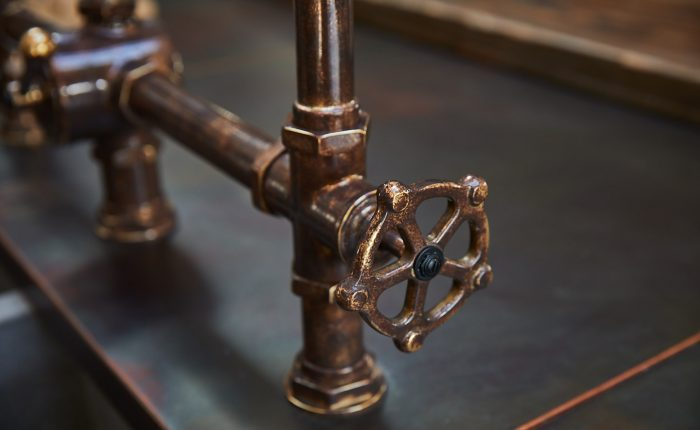Antique kitchen tap with industrial turn handles