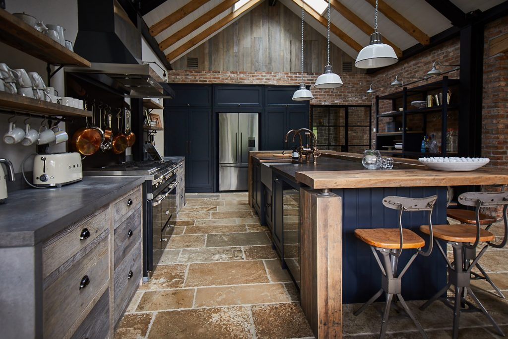 Large vaulted kitchen with reclaimed oak breakfast bar on island with concrete worktops