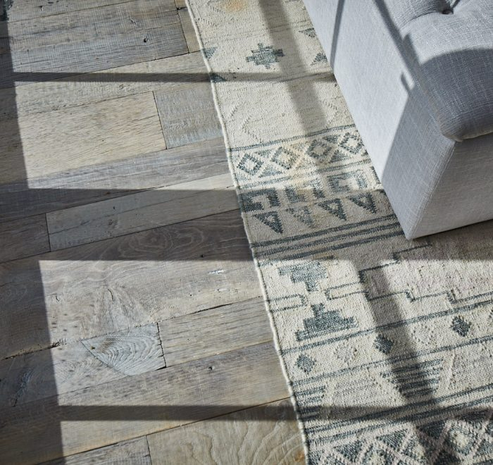 Light shines across reclaimed oak floor boards