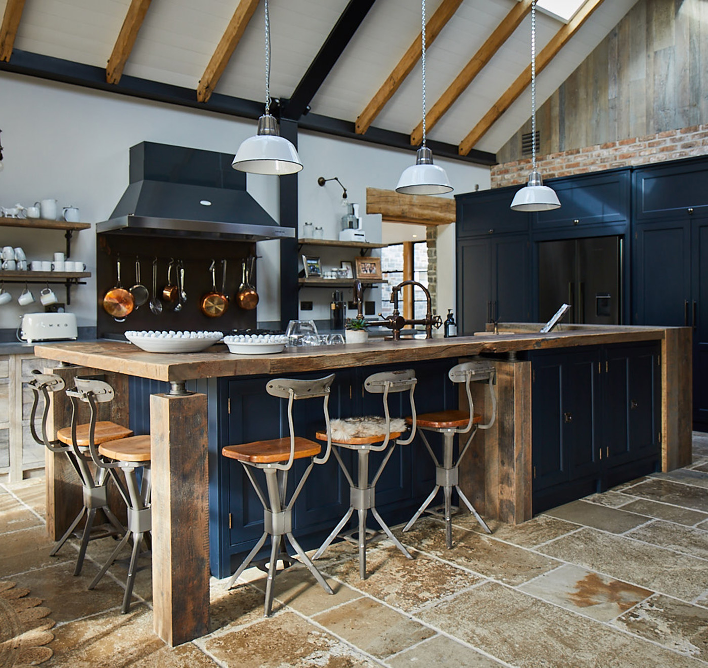 Reclaimed oak breakfast bar with dark blue Little Greene kitchen units