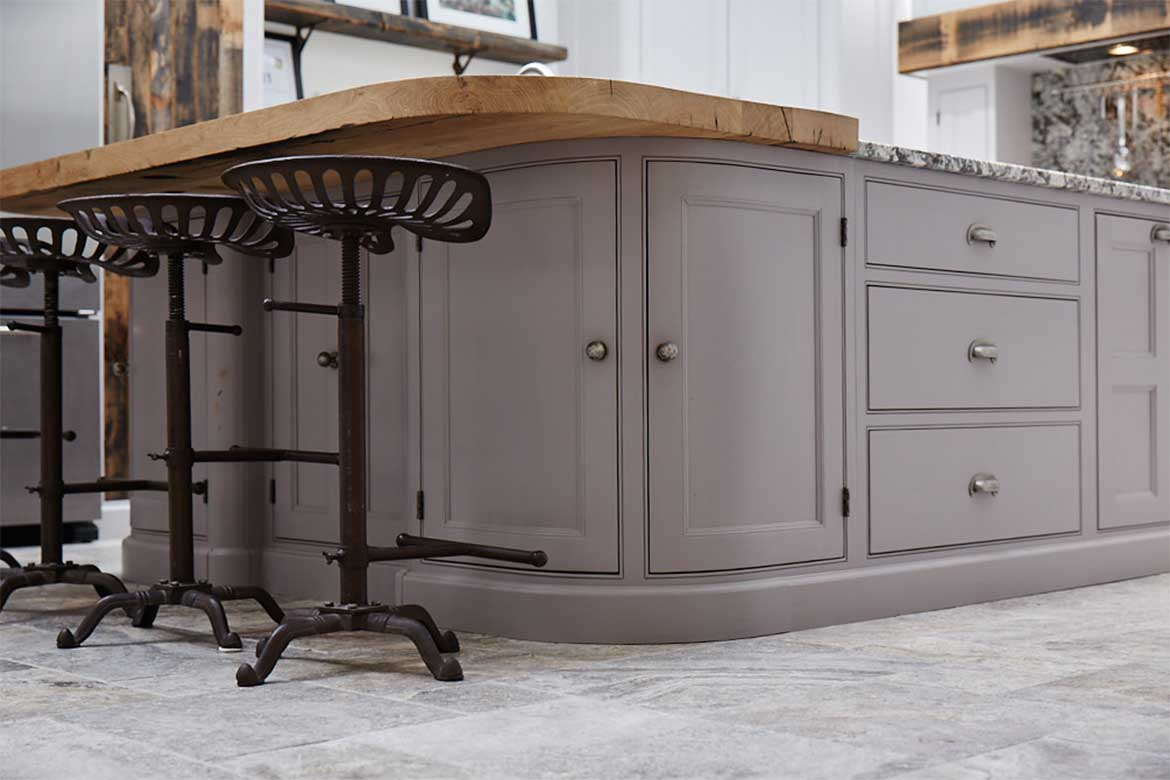 Bespoke kitchen island by The Main Company painted in Little Greene paint with a reclaimed oak breakfast bar and cast iron bar stools