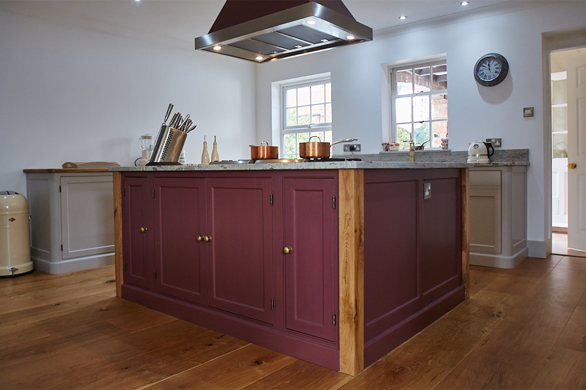 Plum kitchen island with oak posts and matching Westin bespoke cooker hood above