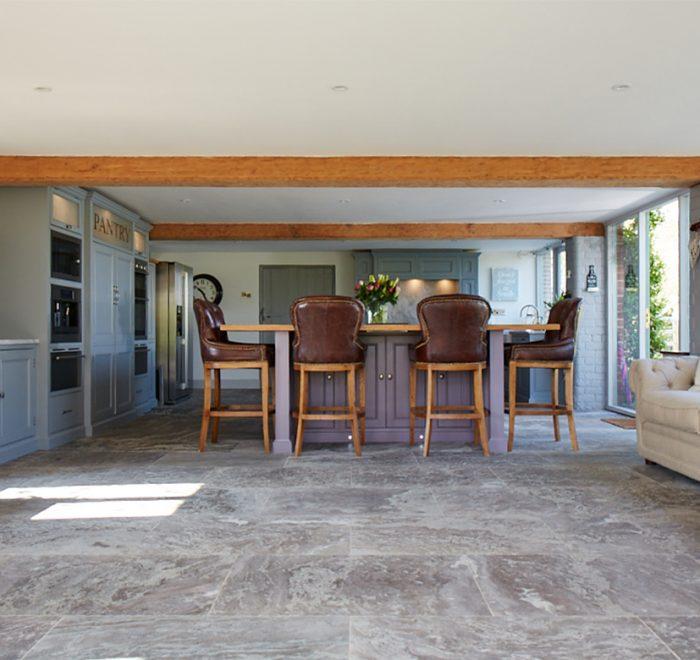 Bespoke kitchen island with 4 grosvenor leather bar stools under solid oak worktop