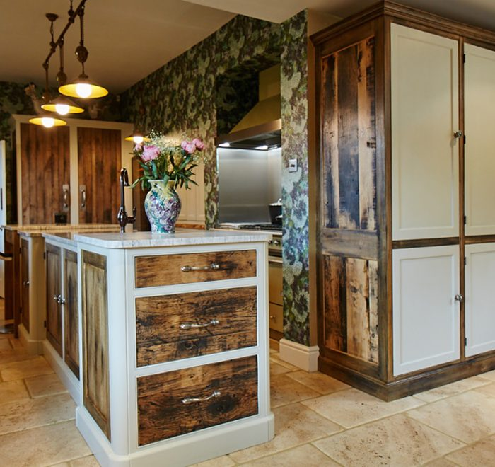 Rustic reclaimed oak drawer fronts with painted grey little green frames on this bespoke kitchen island