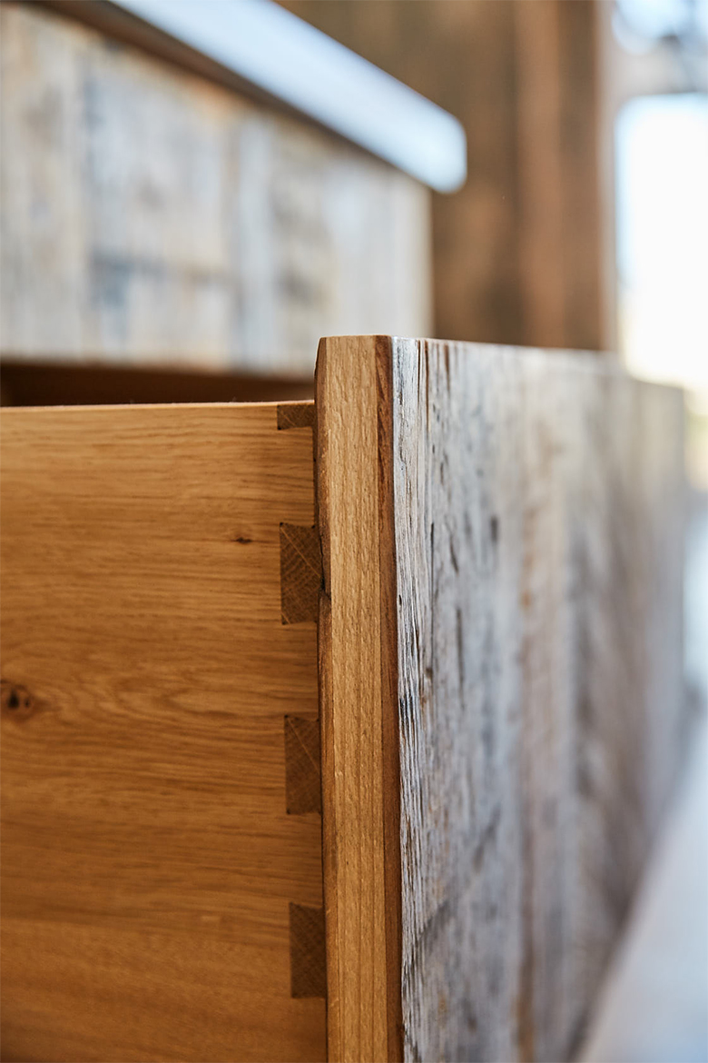 Bespoke dovetails on solid oak drawer boxes with reclaimed engineered pine fronts