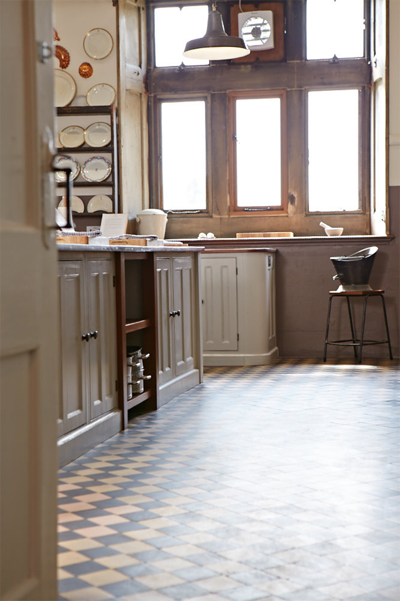 Tiled floor reflects reclaimed teak worktop and bespoke kitchen units