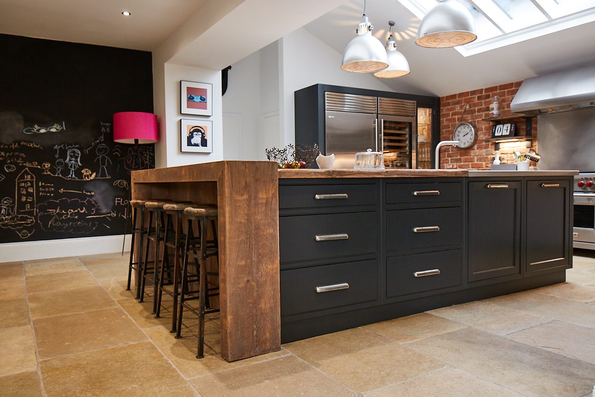 Bespoke kitchen island by The Main Company with reclaimed oak chunky breakfast bar wrap around and rich and deep painted cabinets