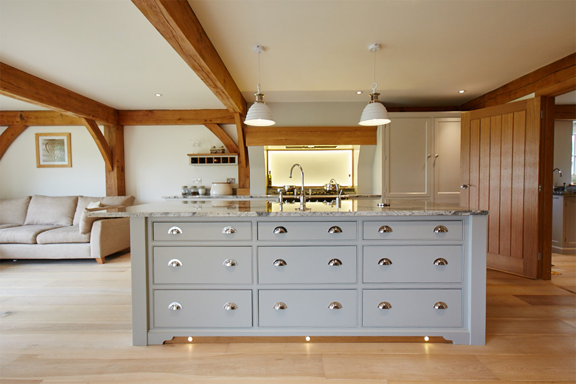A bank of three drawer stacks make up the bespoke kitchen island with two pendant lights above