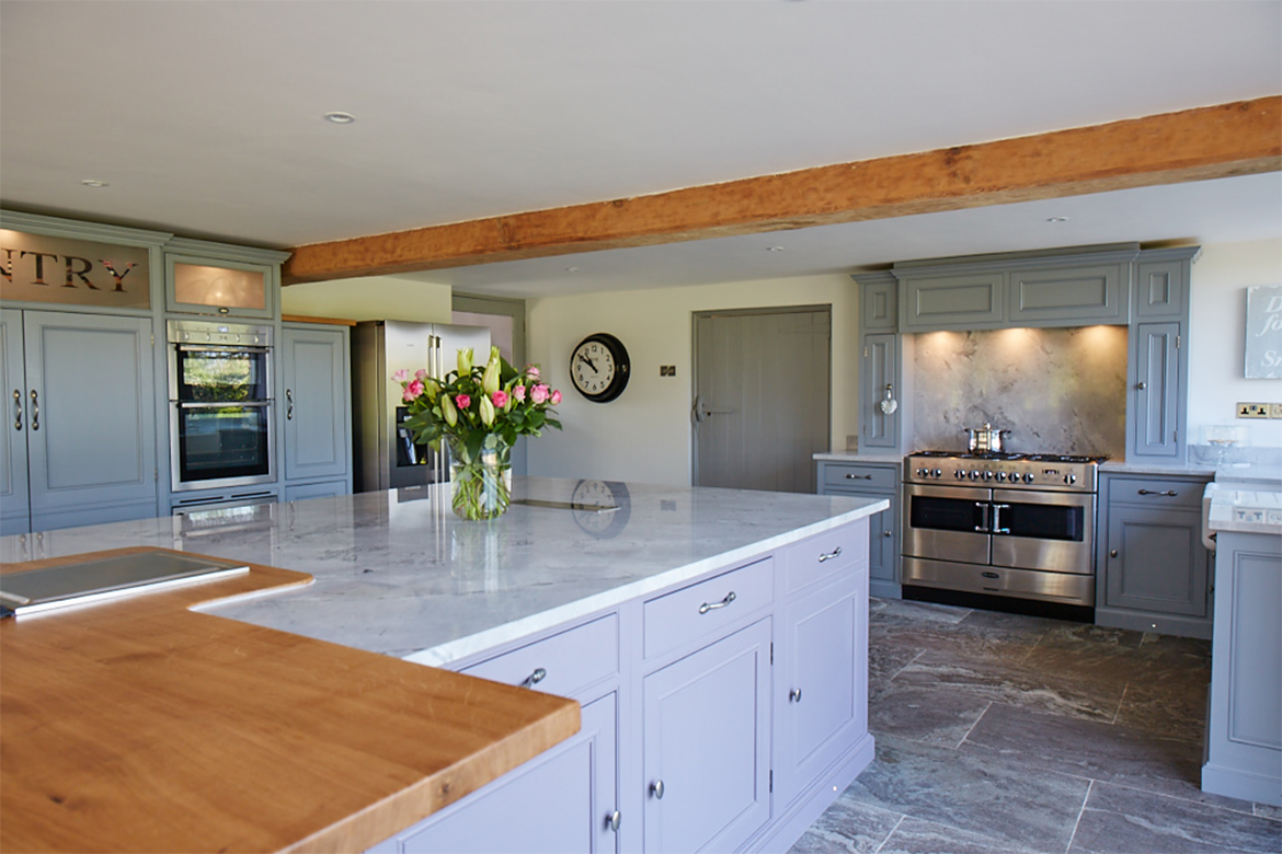 Combination of solid oak and granite worktops sat on bespoke kitchen units