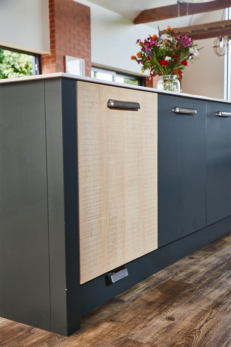 Bespoke kitchen unit with integrated cargo bin from hafele and push foot pedal