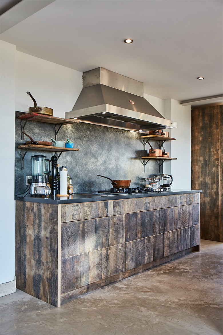 Reclaimed engineered pan drawers with Lacanche stainless steel hood and zinc backsplash