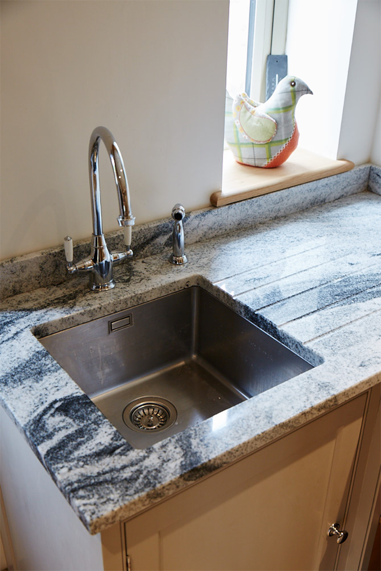 Inset stainless steel sink with granite worktops and chrome mono tap
