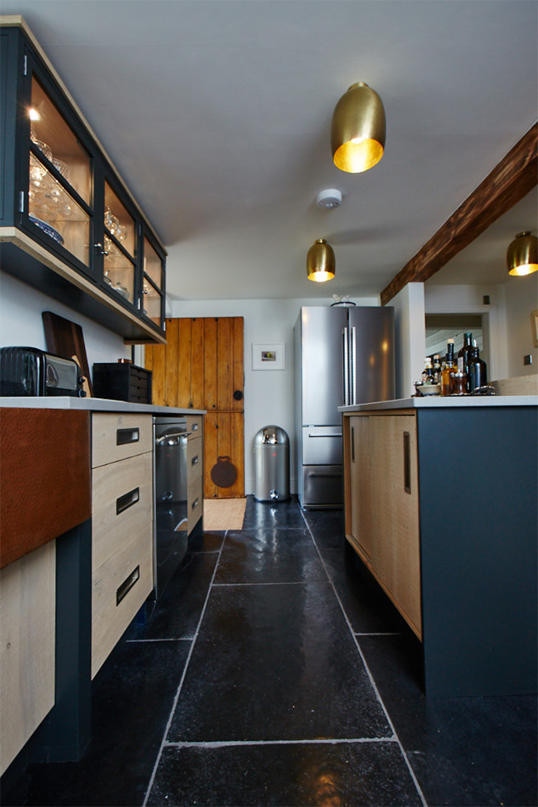 Black slate tiles with the bespoke oak kitchen units on top