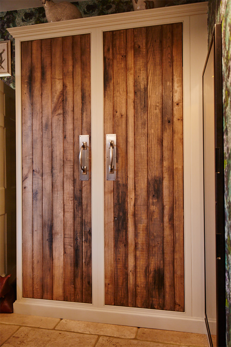 Two tall bespoke larder doors with tongue and groove solid reclaimed rustic oak detail