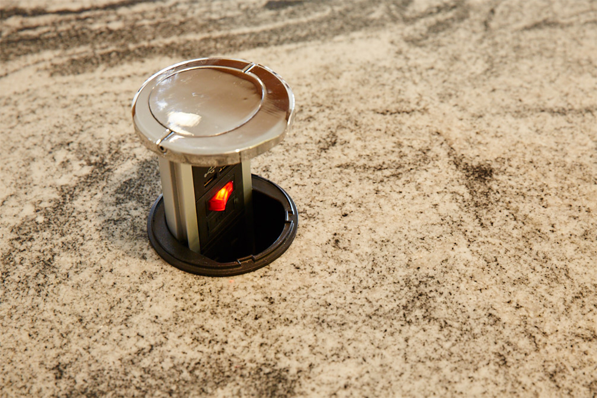 Hafele pop up socket with chrome detail integrated into granite worktop