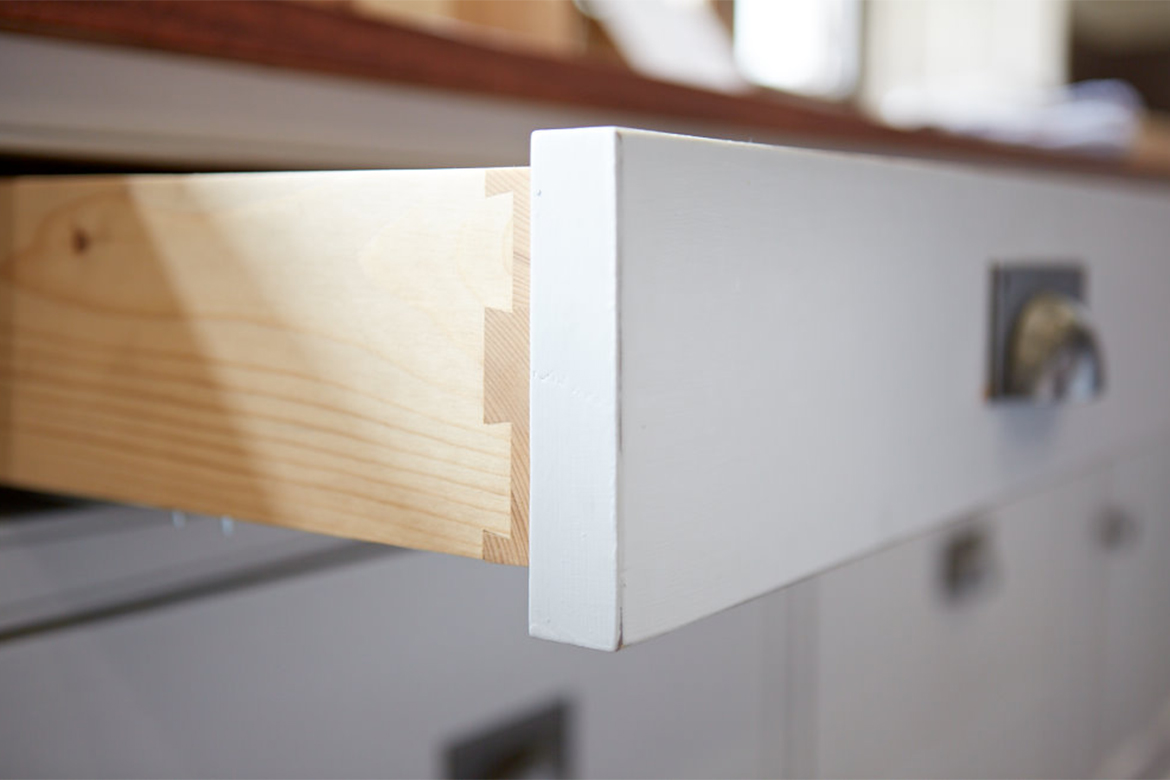 Solid pine drawer box with dovetail joints and pewter cup handles