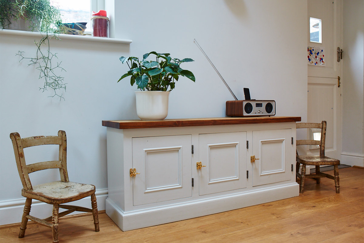 Bespoke painted locker cupboard dressed with vintage chairs, retro radio and plant