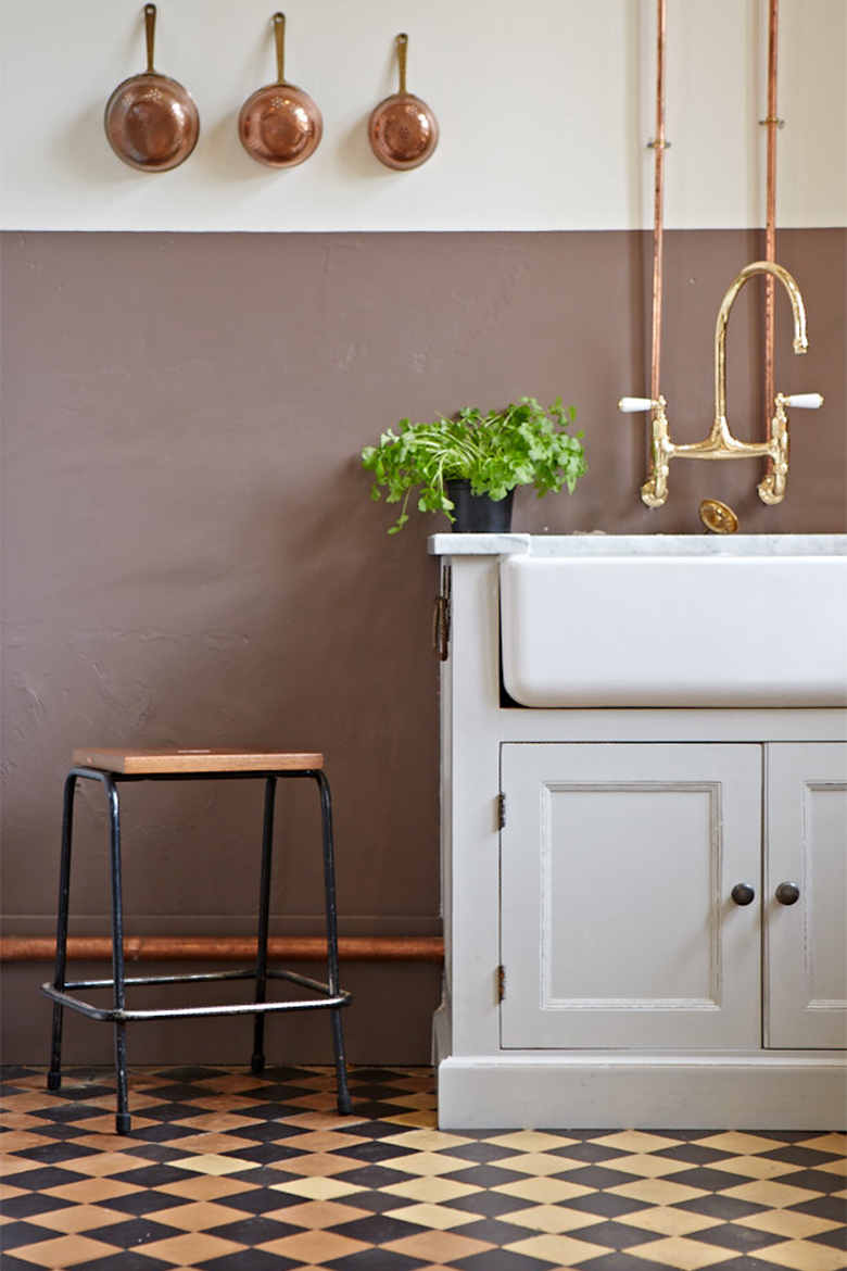 Shaws double belfast sink with gold taps and exposed copper pipes