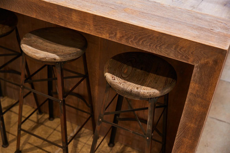 Close up of bespoke breakfast bar made from reclaimed oak