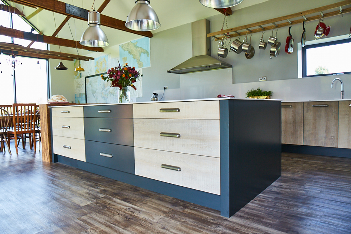 Two tone kitchen island drawers with white wash rustic reclaimed oak and painted little greene drawers fronts finished with finesse pewter handle
