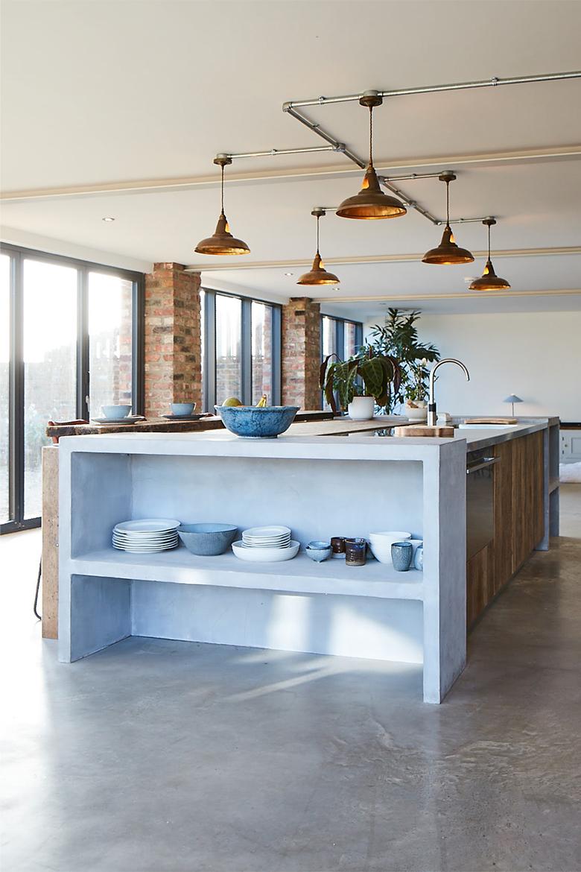 Porcelain sits on light grey concrete bespoke kitchen island bookcase