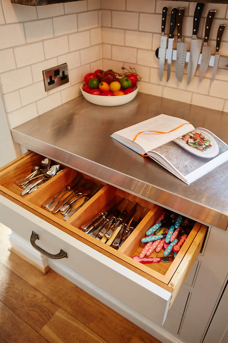 Bespoke kitchen utensil and cutlery divider inside painted cabinet