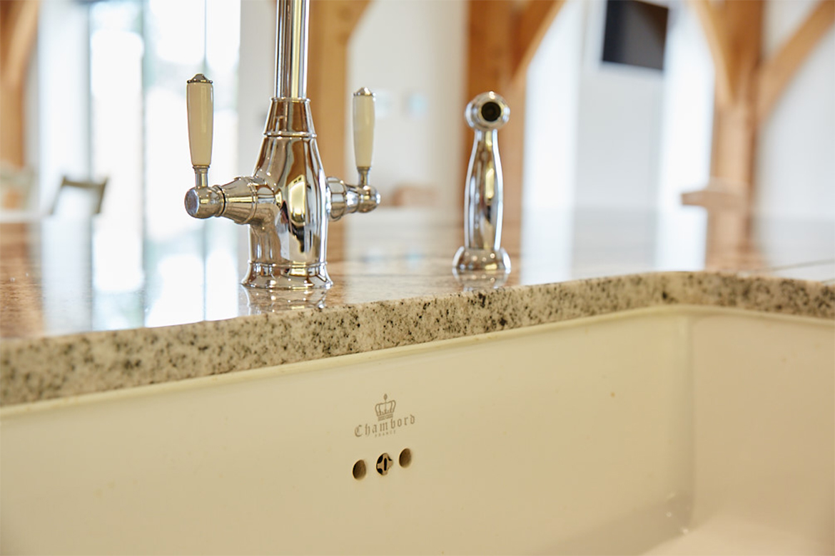 Chambord sink branding with granite worktops and chrome taps