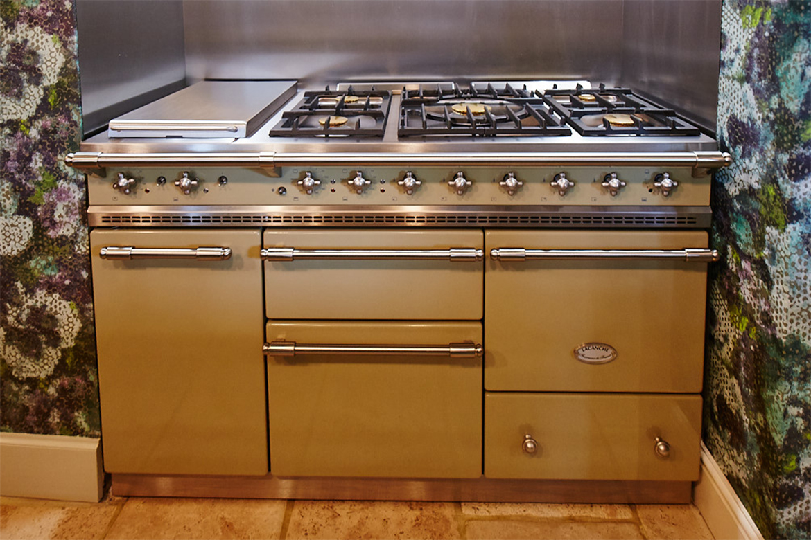 Elevation of green Chaussin Lachance range cooker with brass detail