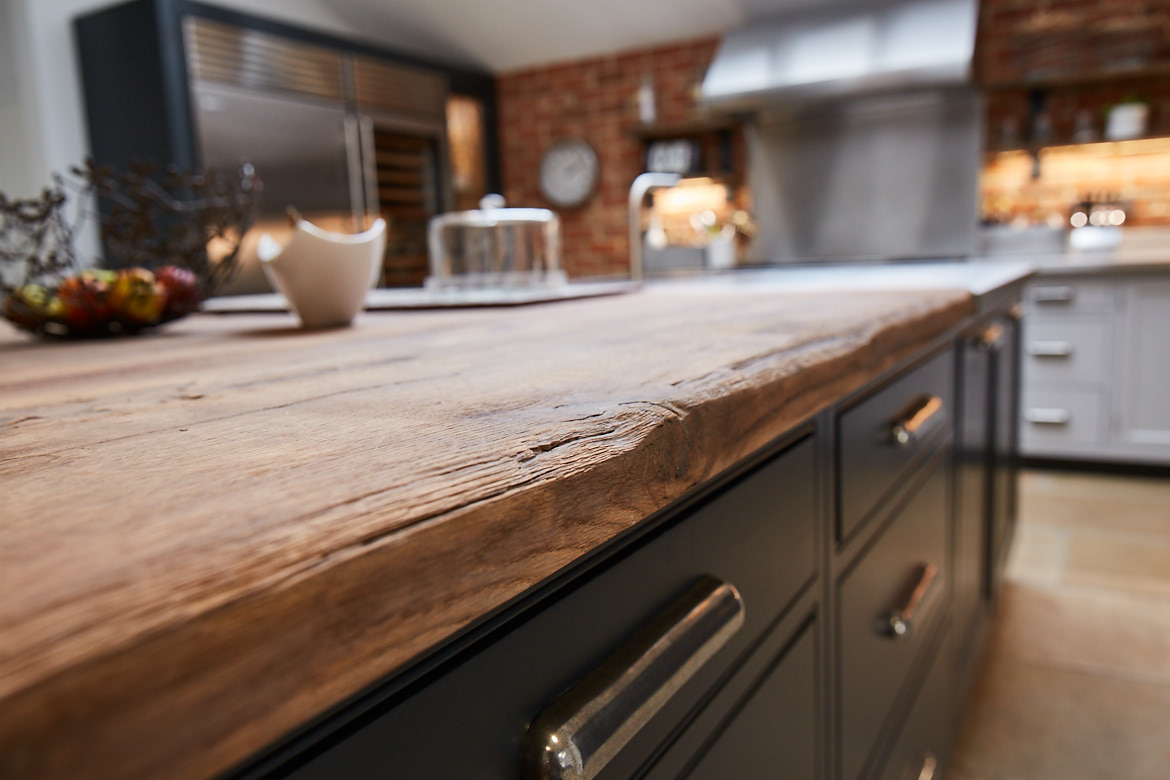 Close up of the a reclaimed oak worktop on the bespoke kitchen island