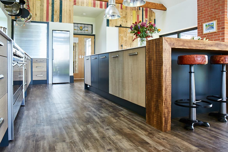 Bespoke kitchen island with wrap around reclaimed wood breakfast bar