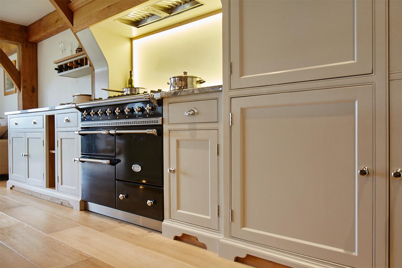 Black Macon Lachance set in-between cream bespoke kitchen cabinets