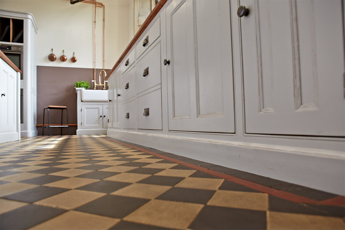 Tiled floor with bespoke kitchen units