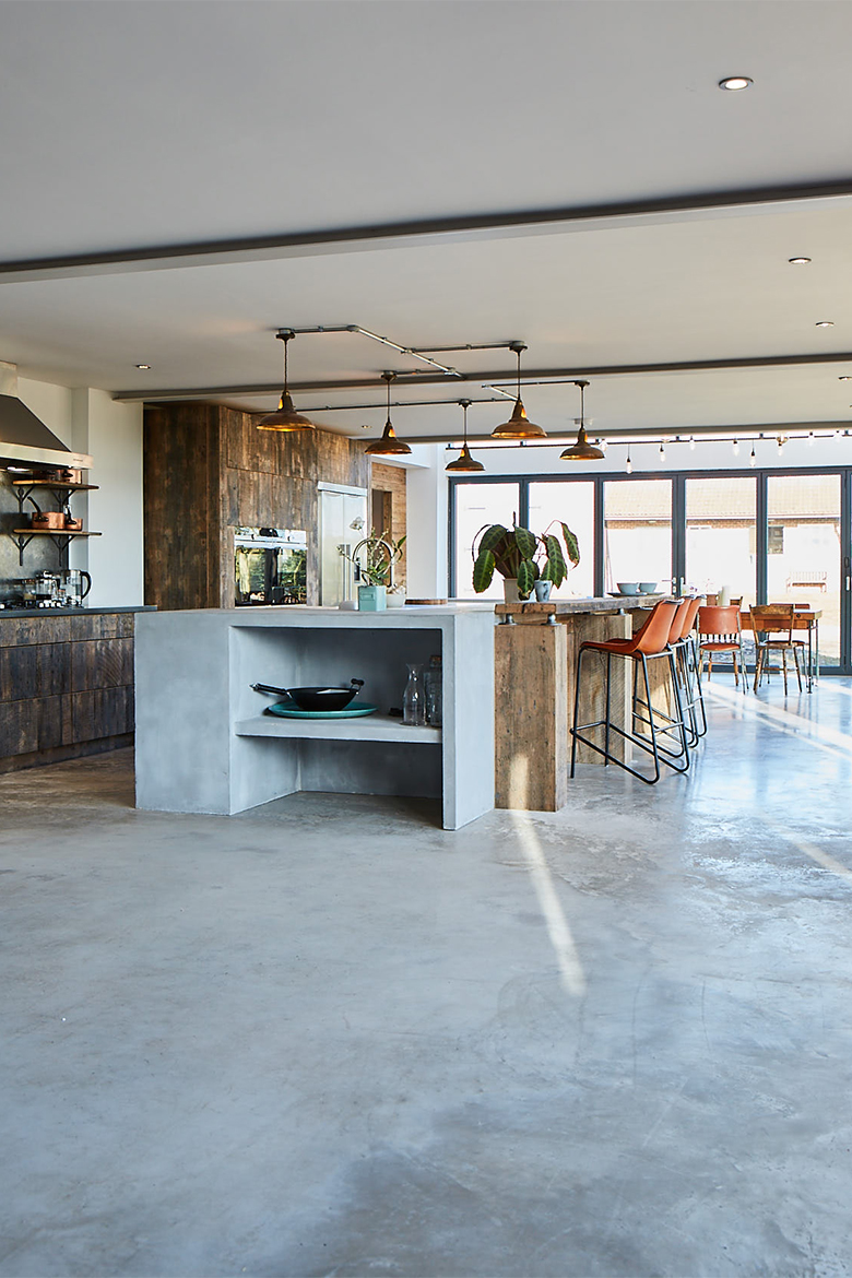 Bespoke kitchen concrete floor with concrete island end and reclaimed oak wood breakfast bar