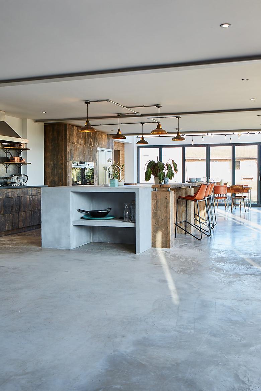 Bespoke kitchen concrete floor with concrete island end and reclaimed oak wood breakfast bar