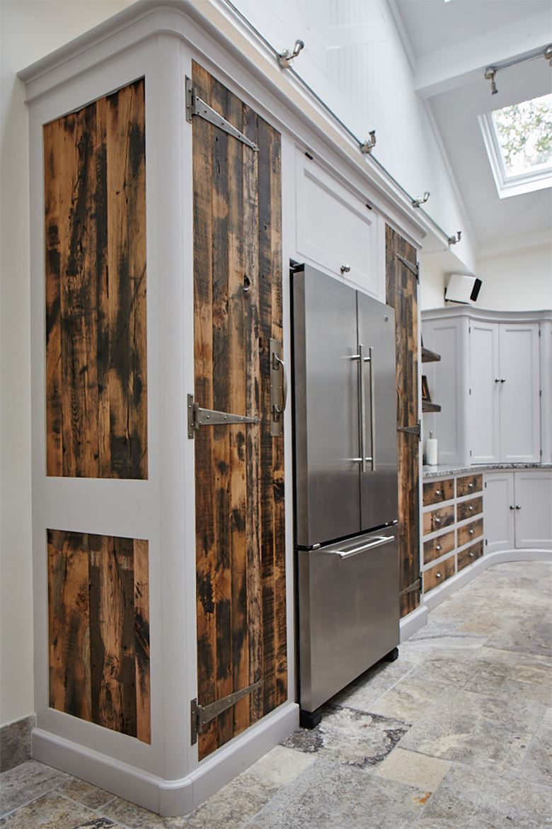 Semi integrated stainless fridge freezer with bespoke reclaimed oak kitchen cabinets