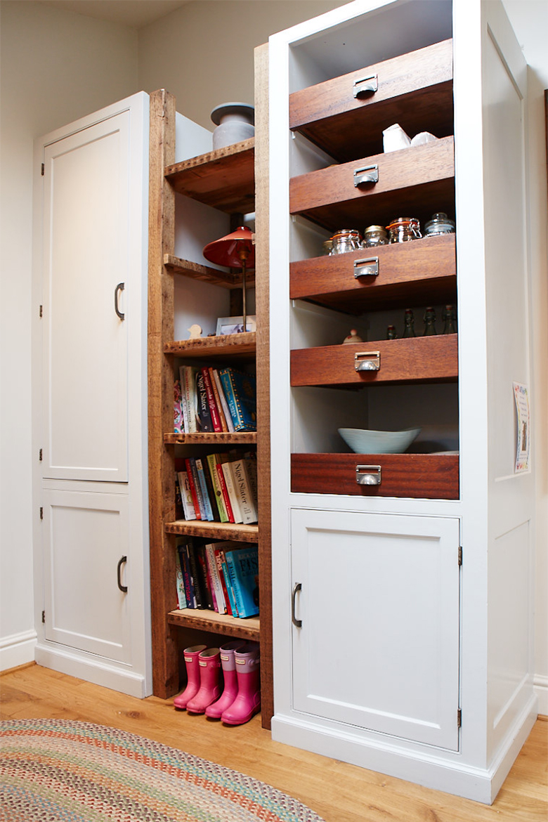 Bespoke painted larder unit with exposed teak drawer boxes and open shelving from reclaimed pine