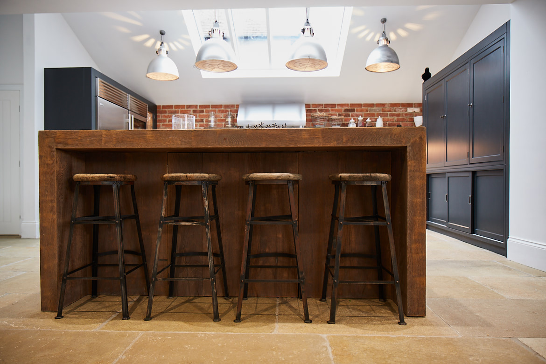 4 industrial reclaimed oak and metal barstools under breakfast bar