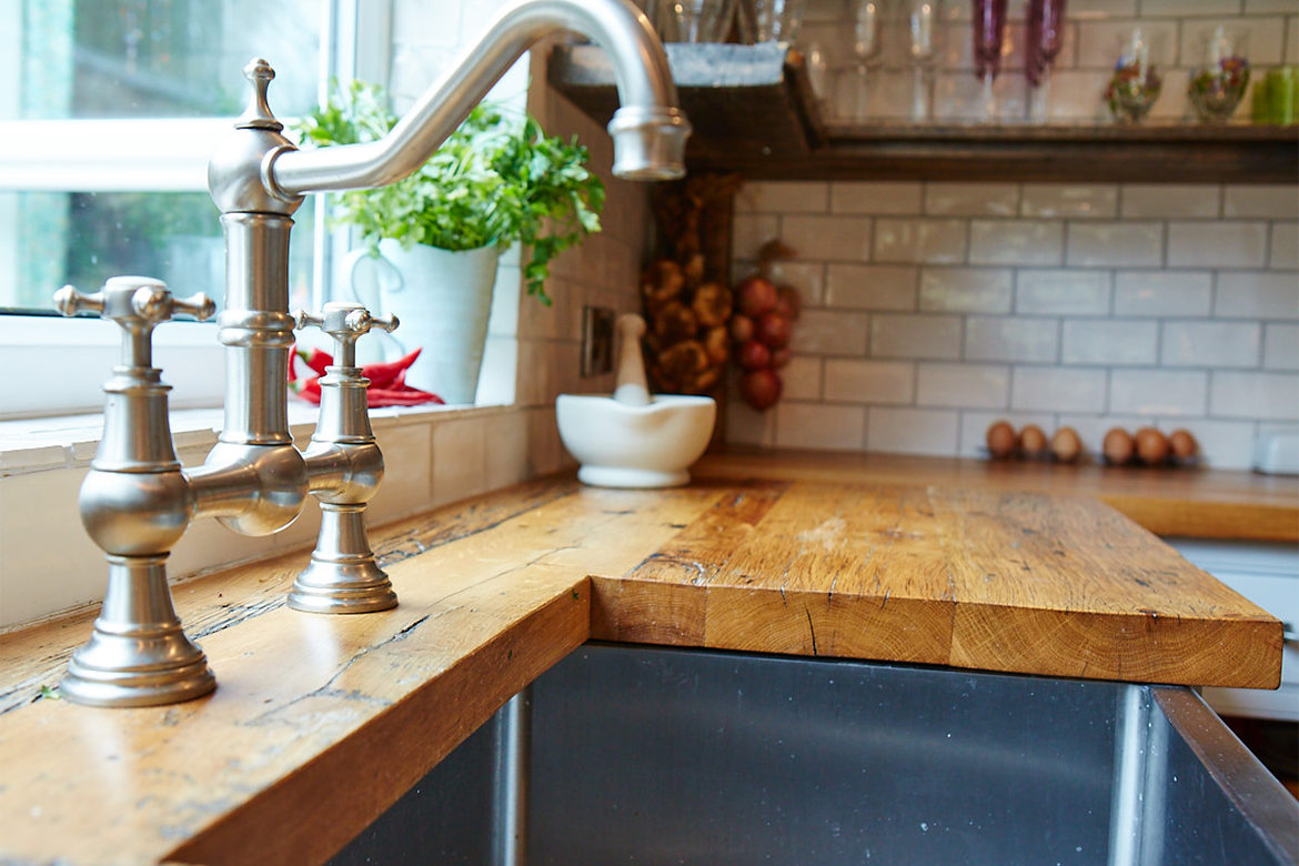 Abode pewter tap with stainless steel belfast sink and reclaimed pine worktops