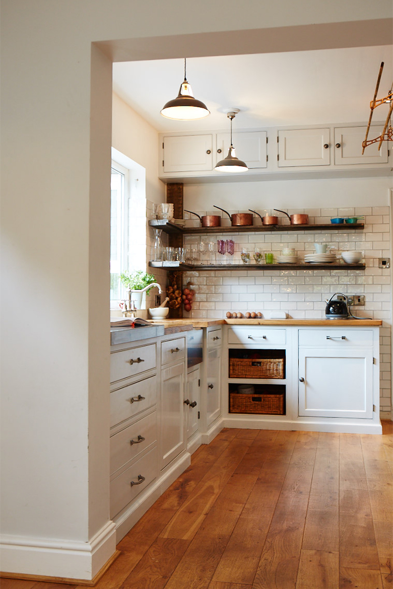 Bespoke painted kitchen with reclaimed pine worktops metro tile walls and open shelves