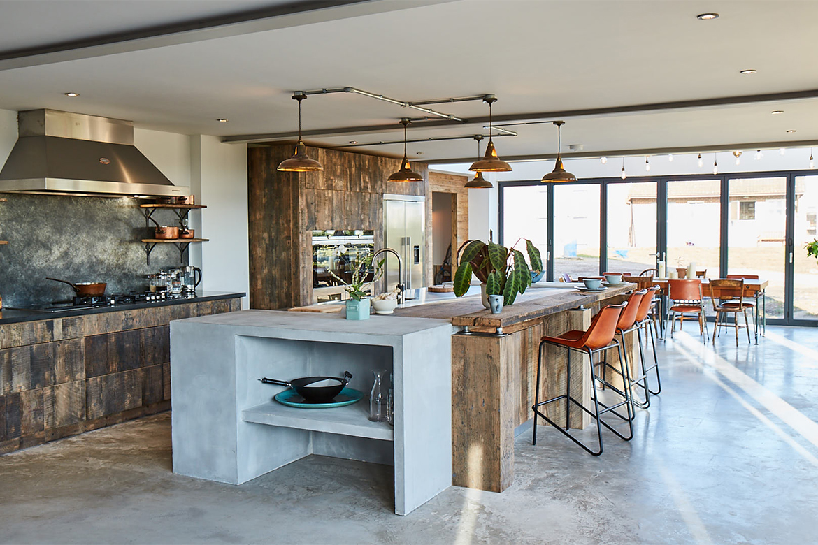 Bespoke kitchen island with concrete ends reclaimed oak wood breakfast bar and stainless steel worktop