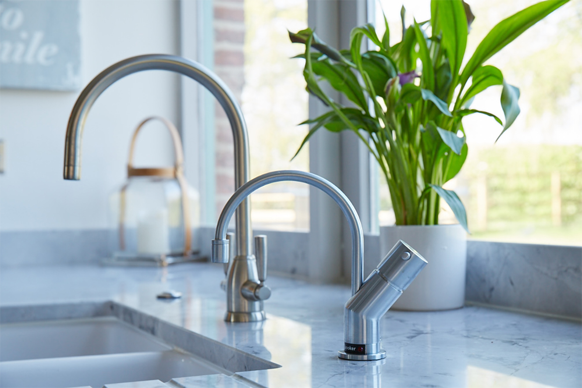 Quooker hot tap sits on granite worktop with ceramic belfast double sink