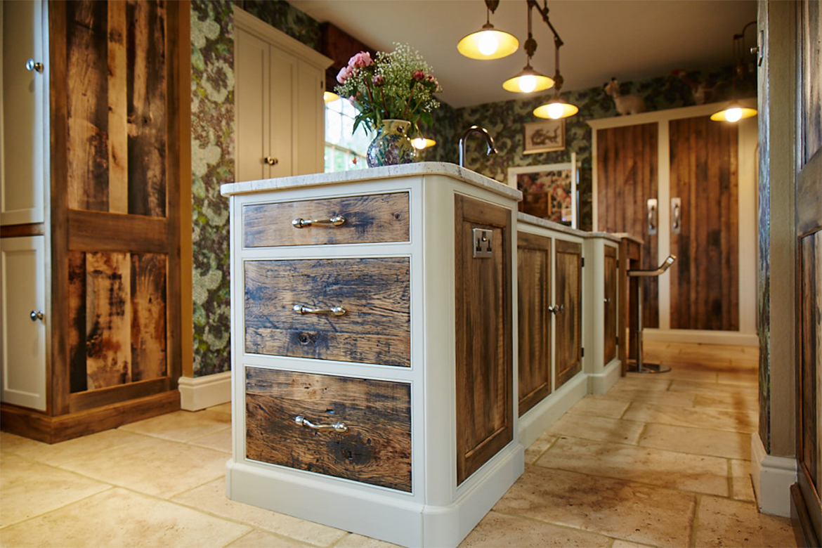 Bespoke kitchen pan drawers manufactured from reclaimed rustic oak framed with painted light grey by Little Greene