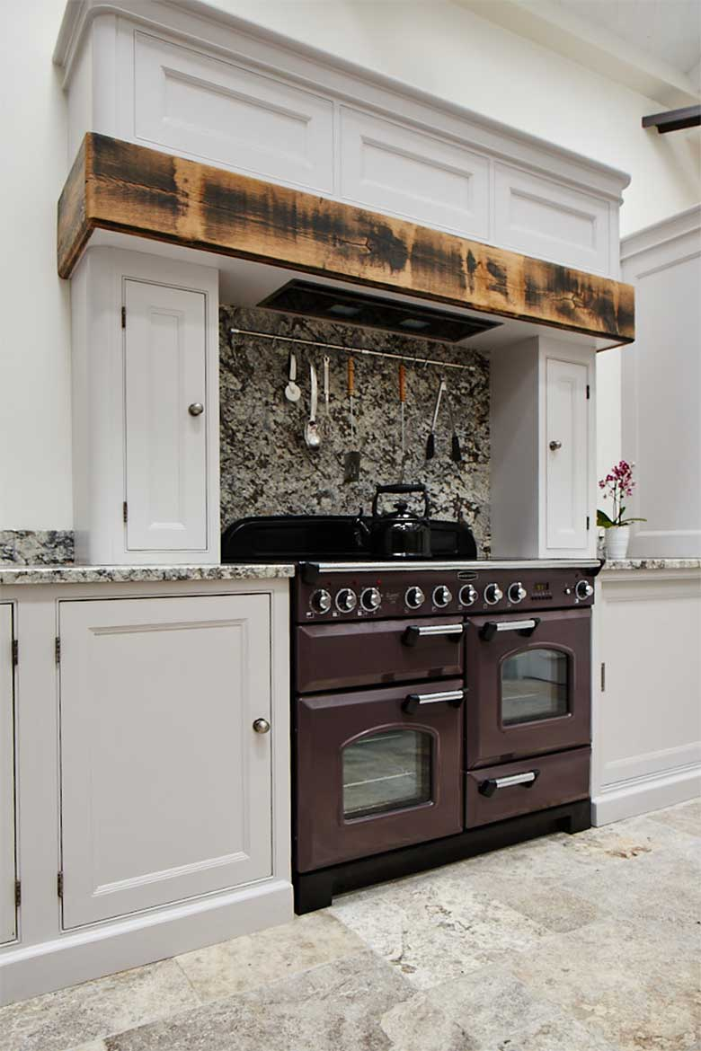 Deep purple range cooker with bespoke reclaimed oak mantle and canopy