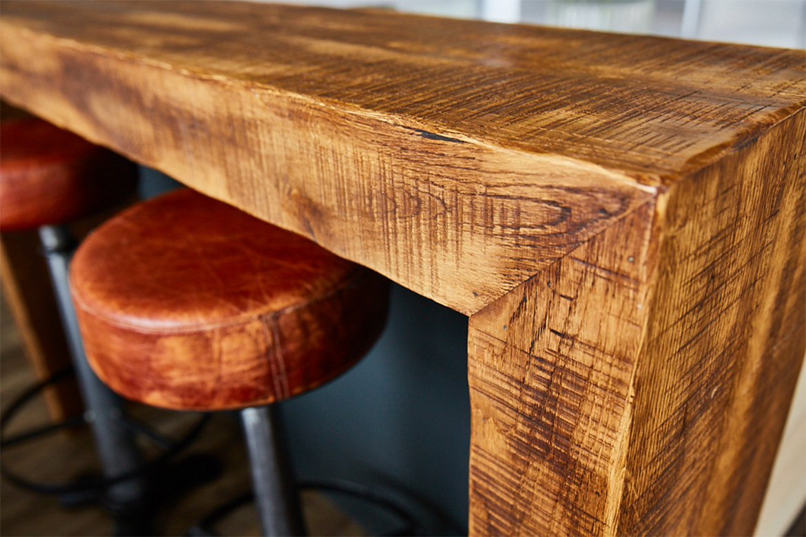 Reclaimed wood wrap around breakfast bar with leather bar stools