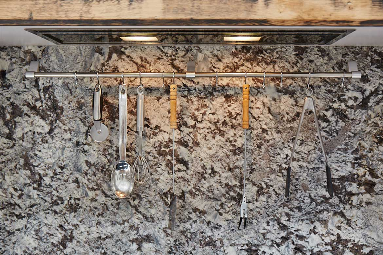 Kitchen utensil rack with granite backsplash