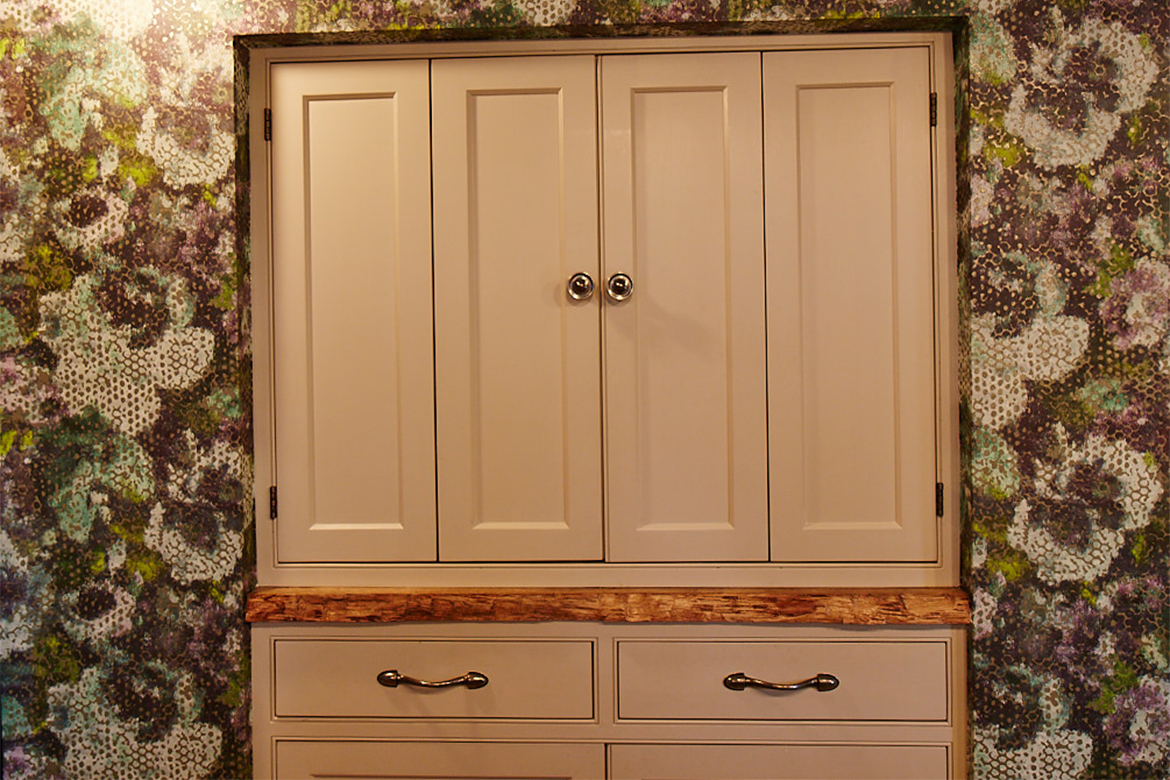 Painted bespoke bi fold unit with pewter Finesse handles and reclaimed oak rustic worktop