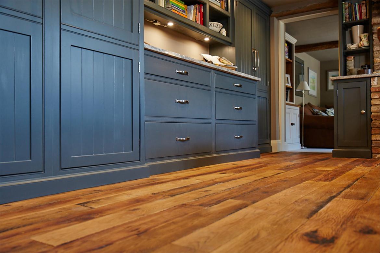 Bespoke painted dark blue kitchen units on engineered oak wood floor