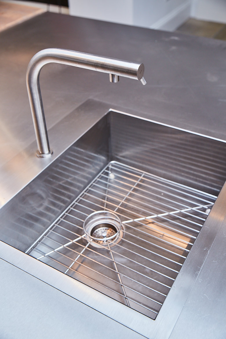 Stainless steel kholer sink with matching modern mono tap overmount on bespoke stainless steel worktop