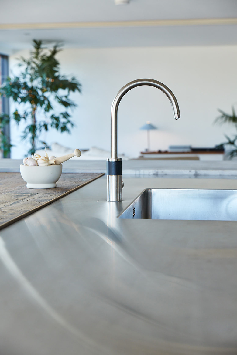 Seamless stainless steel bespoke worktop with Abobe stainless steel mono tap